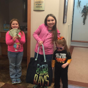 Kids with gift bags and prizes at community event
